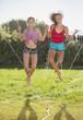 Caucasian girls playing in sprinkler