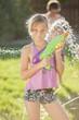 Caucasian girl holding a water gun