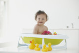Hispanic baby girl taking a bath