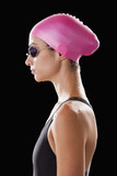 Caucasian swimmer in swim cap and goggles