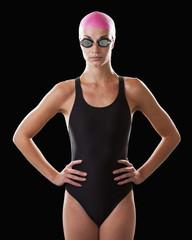 Caucasian swimmer in swim cap and goggles
