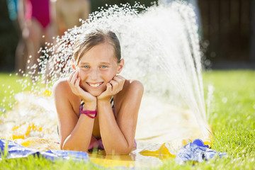 Caucasian girl playing in water