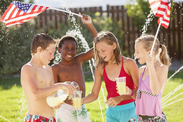 Caucasian friends drinking lemonade on Fourth of July
