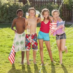 Caucasian friends drinking lemonade on Fourth of July