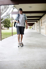 Caucasian teenager riding skateboard