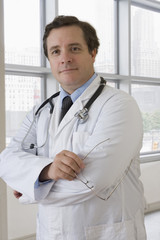 Caucasian doctor with arms crossed