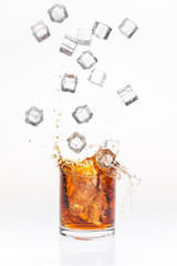 Ice cubes splashing bourbon