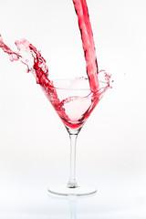 Blended drink splashing into cocktail glass
