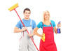 Male and female cleaners with cleaning supplies posing