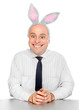 An successful man with rabbit ears.