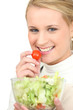 Blond girl eating salad