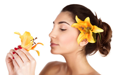 Woman smelling lily flower