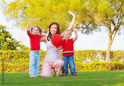 Happy family in spring park