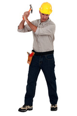 craftsman striking with a hammer