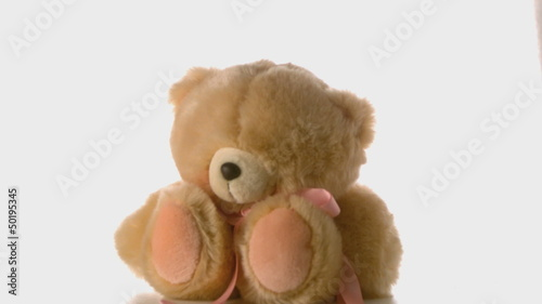 Cute teddy bear falling and bouncing