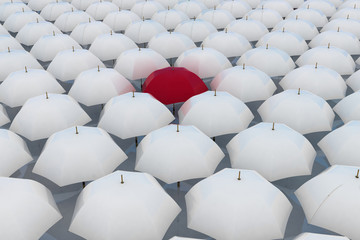 Red umbrella among other white umbrellas