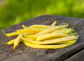 yellow kidney beans on wooden table