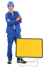 Tradesman with traffic sign
