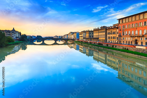 Florence, carraia medieval bridge on Arno river on sunset