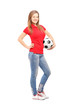 Full length portrait of a young smiling female holding a soccer