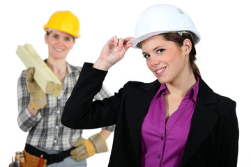 Women with construction helmets
