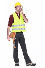 Workman using walkie-talkie on white background