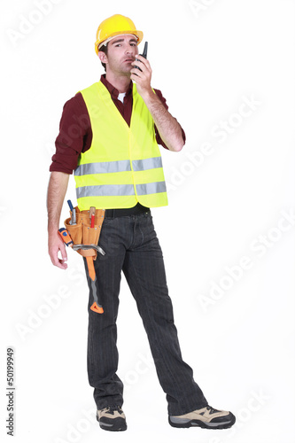 Workman using walkie-talkie on white background