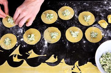 Making fresh handmade spinach ricotta ravioli, overhead