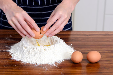 Flour hands eggs raw ingredients