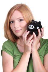 young woman with money box