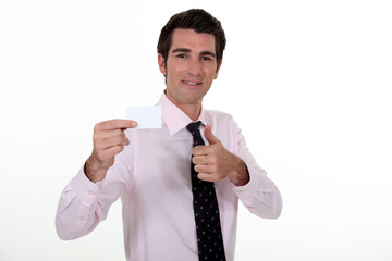 Man confidently displaying business card