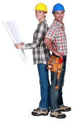 Tradespeople standing back to back
