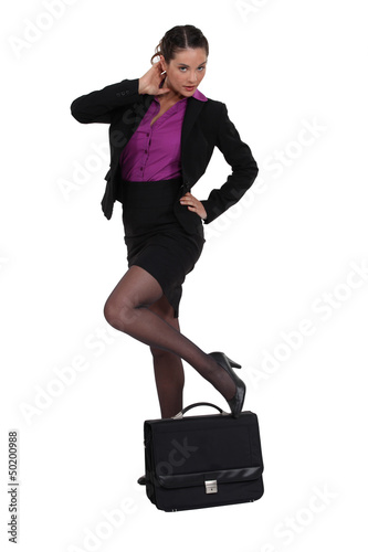 Sexy businesswoman with a briefcase