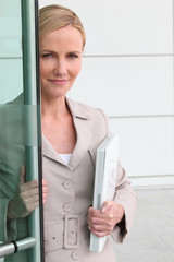 Woman opening door to a collaborator