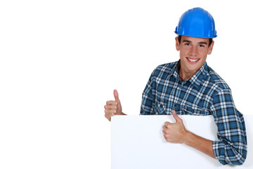 Construction worker approving a board for message