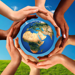 Multiracial Hands Together Around World Globe