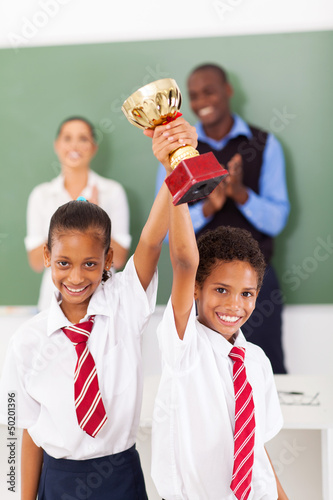 primary students holding a trophy
