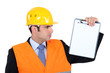 Engineer holding up note-pad