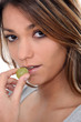 Close-up shot of woman eating grapes