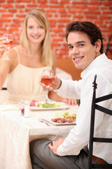 Couple celebrating in restaurant