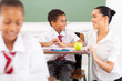 school teacher talking to a student