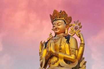 Golden statue of Tibetan Avaloketishvara ( Chenresig ) buddha