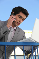 Young businessman outside an office building