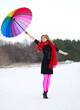 Young woman with multicolor umbrella