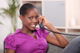 Woman at home on the phone