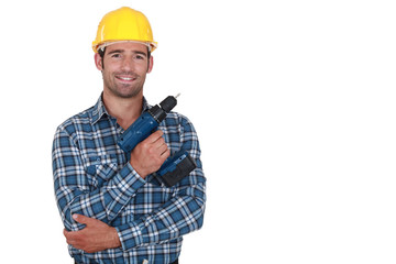 Worker holding cordless drill