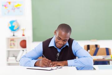 African male teacher preparing a lesson