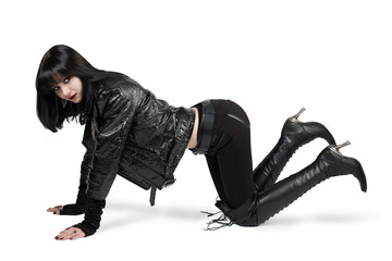 Portrait of young goth woman in lace-up boots