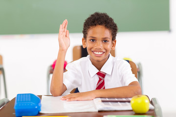 primary schoolboy hand up in  classroom
