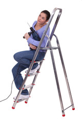 Handywoman sat on a ladder